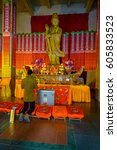 Small photo of SHANGHAI, CHINA - 29 JANUARY, 2017: Religious alter in yellow and red colored theme, golden buddha statue standing at center, located at Jing'an temple traditional chinese neighborhood