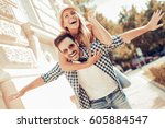happy young couple hugging and... | Shutterstock . vector #605884547