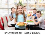 cute girl holding plate with...   Shutterstock . vector #605918303