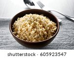 bowl full of brown rice on... | Shutterstock . vector #605923547