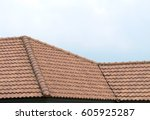 roof house with tiled roof on... | Shutterstock . vector #605925287