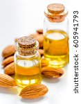 Small photo of organic cosmetic with almond extract on table background