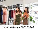 two beautiful vietnamese ladies ... | Shutterstock . vector #605983247