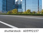 clean asphalt road with city...   Shutterstock . vector #605992157