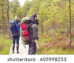 two bearded men walking in... | Shutterstock . vector #605998253