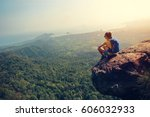 successful woman hiker enjoy... | Shutterstock . vector #606032933
