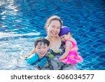 asian mother with her children... | Shutterstock . vector #606034577