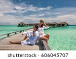 couple in white on a tropical... | Shutterstock . vector #606045707