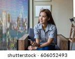 happy asian businesswoman... | Shutterstock . vector #606052493