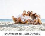 group of four friends sits on... | Shutterstock . vector #606099083