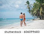 a loving couple on the beach | Shutterstock . vector #606099683