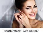 cheerful bride smiles bride... | Shutterstock . vector #606130307