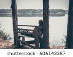 pensive man on the high edge of ... | Shutterstock . vector #606143387