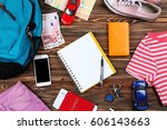 travel accessories on wooden... | Shutterstock . vector #606143663