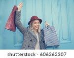 happy young girl satisfied... | Shutterstock . vector #606262307