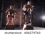 fitness couple jumping on... | Shutterstock . vector #606274763