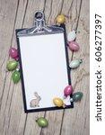 eastereggs on wood background...   Shutterstock . vector #606277397