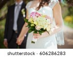 groom and bride holds wedding... | Shutterstock . vector #606286283
