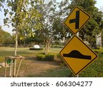 Small photo of T junction and bump traffic sign