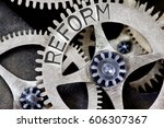 Small photo of Macro photo of tooth wheel mechanism with REFORM concept words