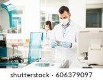 attractive young chemists with... | Shutterstock . vector #606379097