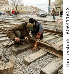 Small photo of ODESSA, UKRAINE -20 March 2017: Repair iron tram line. Installation of railway rails for trams. Laying stone pavers, road paving slabs on street. Repair reconstruction of urban highways with tram line