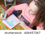 little girl drawing at home...   Shutterstock . vector #606457367