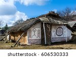 Small photo of Time travel. Horizontal view of abode ancient people (reconstruction)