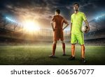 two soccer players on a stadium | Shutterstock . vector #606567077