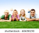 portrait of happy family lying... | Shutterstock . vector #60658150
