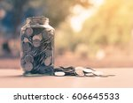 coins in glass jar with blur... | Shutterstock . vector #606645533