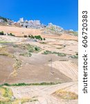 Small photo of travel to Italy - agrarian fields and ruins in southern Sicily in summer day