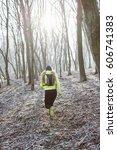 runner is running through misty ...   Shutterstock . vector #606741383