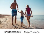 happy family hold hands and run ... | Shutterstock . vector #606742673
