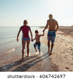 happy family hold hands and run ... | Shutterstock . vector #606742697