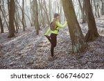 young woman runner warm up...   Shutterstock . vector #606746027