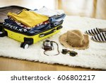 preparation travel suitcase at... | Shutterstock . vector #606802217
