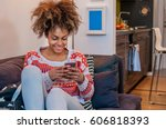 african american woman using... | Shutterstock . vector #606818393