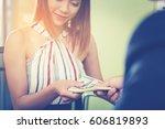 businessman's hand is giving... | Shutterstock . vector #606819893