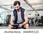 thoughtful man using tablet at... | Shutterstock . vector #606845123