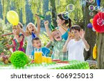 children with party hats and... | Shutterstock . vector #606925013
