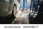 big white car in car service... | Shutterstock . vector #606948677