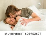 cute couple cuddling in their... | Shutterstock . vector #606963677