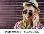 smiling woman touching her... | Shutterstock . vector #606992237