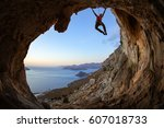 young woman climbing on ceiling ...
