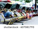 vintage trishaw stop beside... | Shutterstock . vector #607081793