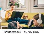 woman wearing yellow sweater... | Shutterstock . vector #607091807