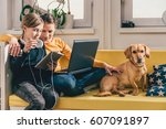 mother and daughter sitting on... | Shutterstock . vector #607091897