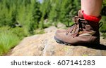 walking in the mountains in a... | Shutterstock . vector #607141283