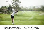 lady golf swing on golf course | Shutterstock . vector #607156907